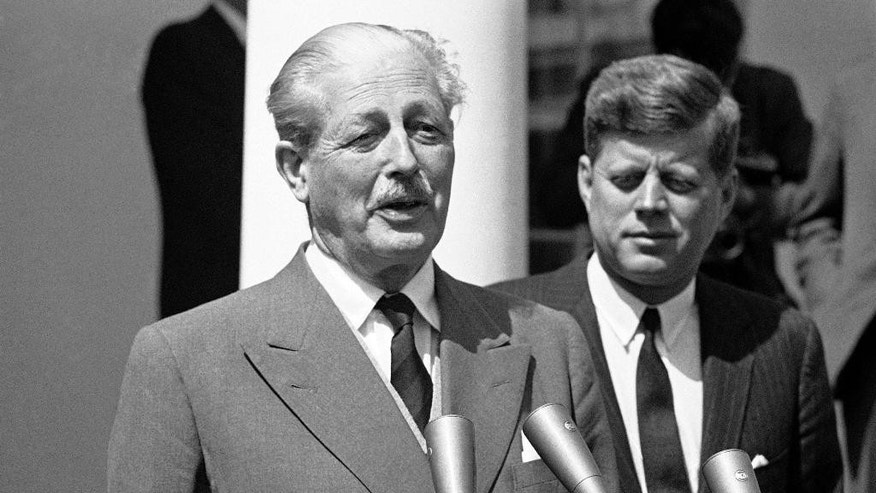 "FILE - This is an April 8, 1961 file photo of British Prime Minister Harold Macmillan as he speaks briefly outside the White House, Washington  with President Kennedy. In 1955, Winston Churchill was replaced by Anthony Eden who then won the ensuing general election. Eden's premiership proved short-lived after his misguided attempt to regain the Suez Canal from Egypt in 1956. Eden resigned a year later, replaced by Harold Macmillan, who led the Conservatives to their third straight election victory in 1959. Macmillan famously claimed the British had ""never had it so good."" (AP Photo/File)"
