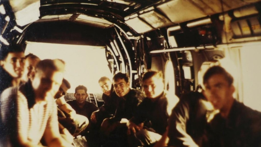 This April 30, 1975 photo provided by former U.S. Marines Master Gunnery Sgt. Juan Valdez of Oceanside, California, shows himself, rear center, sitting on the last helicopter leaving the U.S. Embassy in Saigon, Vietnam. On the 40th anniversary of the fall of Saigon, 13 Marines returned to dedicate a plaque to their two fallen brothers at the site of the old embassy, which is now the U.S. Consulate. (AP Photo/Courtesy of Juan Valdez via AP)