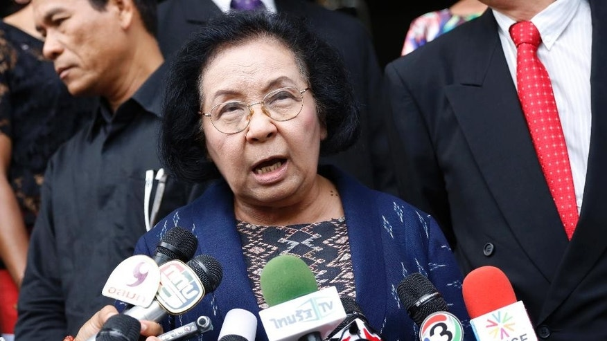 Former Chairwoman of the United Front for Democracy against Dictatorship (UDD) or Red Shirts, Thida Thavornseth talks to reporters as she leaves the Bangkok South Criminal Court in Bangkok, Thailand Thursday, April 30, 2015. An inquest into the death of a Reuters video journalist shot during a Thai military crackdown on protesters in 2010 has ended inconclusively, with the court saying it cannot determine if soldiers or protesters fired the fatal shot. (AP Photo/Sakchai Lalit)