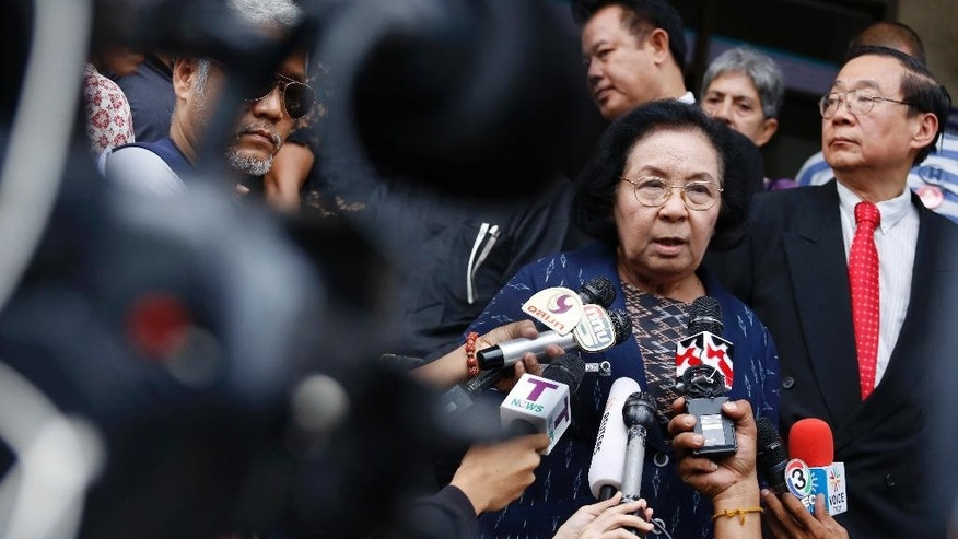 Former Chairwoman of the United Front for Democracy against Dictatorship (UDD) or Red Shirts, Thida Thavornseth, second right, talks to reporters as she leaves the Bangkok South Criminal Court in Bangkok, Thailand Thursday, April 30, 2015. An inquest into the death of a Reuters video journalist shot during a Thai military crackdown on protesters in 2010 has ended inconclusively, with the court saying it cannot determine if soldiers or protesters fired the fatal shot. (AP Photo/Sakchai Lalit)