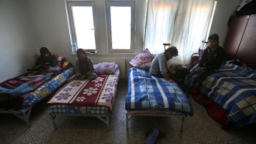 In this picture taken on Friday, April 17, 2015, Syrian rebel patients, sit on their beds at the Dar Al-Salameh center for recovery and physiotherapy, in Kilis town near the Syrian border, Turkey. Turkey, a major supporter of the rebels fighting to topple Syrian President Bashar Assad, has served as a staging area for the fighters, where many also come to rest and recover.  (AP Photo/Hussein Malla)