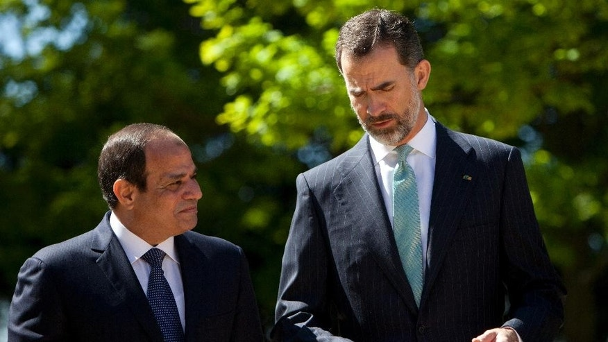 President of  Egypt, Abdel Fattah el-Sissi, left, and King Felipe VI of Spain, speak during their meeting at Zarzuela Palace in Madrid, Spain on Thursday, April 30, 2015. (AP Photo/Abraham Caro Marin)