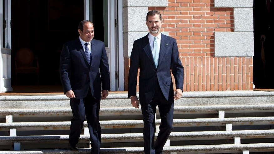 President of the Republic from Egypt, Abdel Fattah el-Sissi, left, and King Felipe VI of Spain, right, walking down the stairs during his meeting at Zarzuela Palace in Madrid, Spain on Thursday, April 30, 2015. (AP Photo/Abraham Caro Marin)
