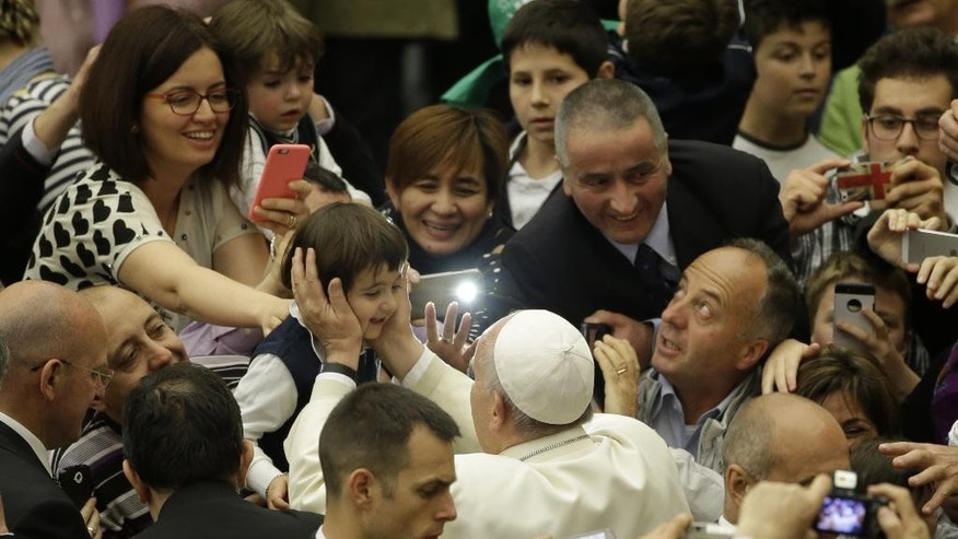 Pope Francis arrives for an audience with members of the ' Christian Life ' community, in the Paul VI hall, at the Vatican, Thursday, April 30, 2015. (AP Photo/Andrew Medichini)