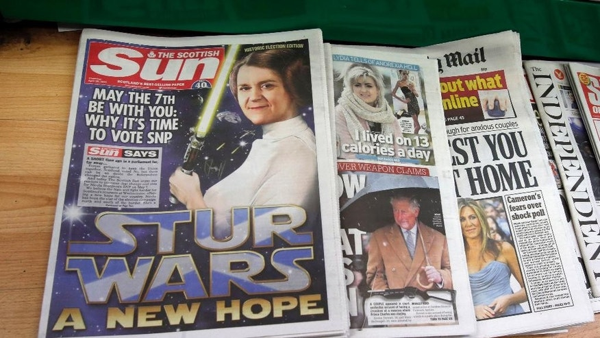"The Scottish Sun in a shop in Edinburgh, as the newspaper comes out in favour of the Scottish National Party, Thursday April 30, 2015. Rupert Murdoch's tabloid Sun has spoken, urging voters to back David Cameron's Conservative Party in Britain's election — unless they're in Scotland. There, it says, they should vote for the Scottish National Party. The differing endorsements raised a few eyebrows Thursday, since the London-based Sun dubbed the pro-Scottish independence nationalists ""saboteurs"" determined to wreck Britain. ( Danny Lawson/PA via AP)  UNITED KINGDOM OUT  NO SALES  NO ARCHIVE"