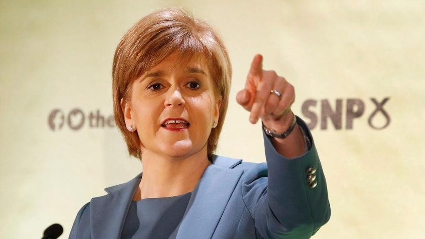"Scotland's First Minister, Nicola Sturgeon, delivers a keynote speech during a press conference in Glasgow, Scotland, as the Scottish National Party leader insisted Wednesday April 29, 2015, that the General Election is ""not about independence"" for the party. Britain goes to the polls in a General Election on May 7. (Danny Lawson/PA via AP) UNITED KINGDOM OUT  NO SALES  NO ARCHIVE"
