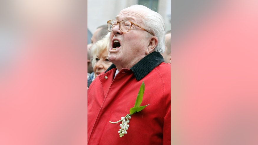 "France's far-right National Front party's founder Jean-Marie Le Pen screams ""Help Jeanne d'Arc"" after he places a wreath at Joan of Arc statue during its annual May Day march, in Paris, France, Friday, May 1, 2015. France's far-right National Front is holding its annual May Day march, but for the first time the party's founder Jean-Marie Le Pen _ on the outs with his daughter who presides over the party _is not taking a seat at the tribune. (AP Photo/Francois Mori)"