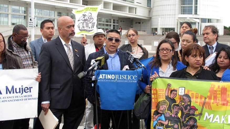 Joselo Lucero, center, the brother of an Ecuadorean immigrant killed by a group of Long Island teenagers in 2008, speaks at a press conference, Thursday, April 30, 2015, outside the U.S. District Courthouse in Central Islip, N.Y. Lucero joined advocates for Latinos in announcing a lawsuit that Latinos were unjustly targeted for traffic stop by members of Suffolk County's police department. (AP Photo/Frank Eltman)