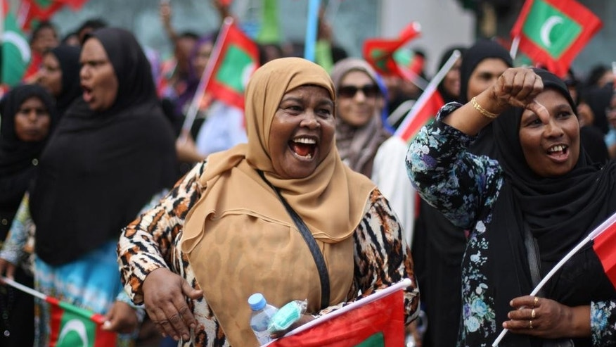 Opposition supporter shout slogans during a protest demanding Maldives President Yameen Abdul Gayoom resign and jailed ex-president Mohamed Nasheed be freed, in Male', Maldives, Friday, May 1, 2015. The thousands of protesters marching in one of the biggest marches in Male accused Gayoom of jailing Nasheed and others who he sees as political threats. (AP Photo/Sinan Hussain)