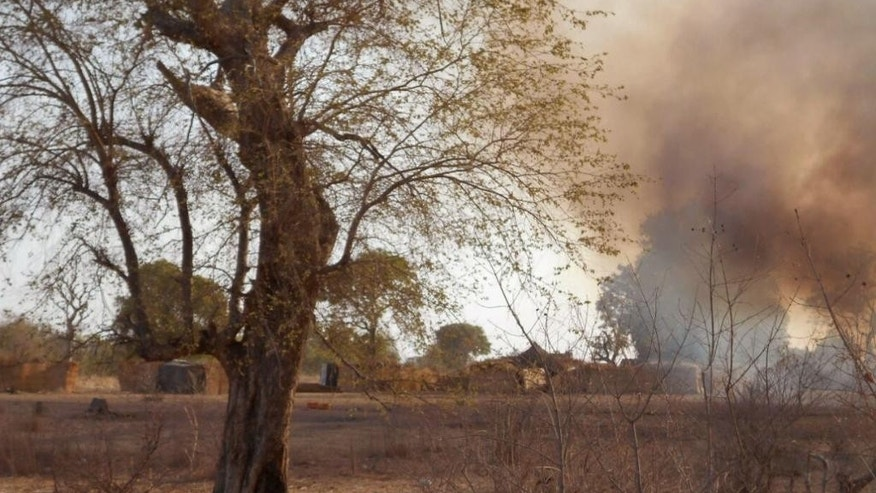 In this photo made available by the Nigerian Military taken Tuesday, April 28, 2015, a pall of smoke hangs over an Islamic extremist camp, after it was allegedly destroyed by Nigerian military personnel during a attack on Islamic extremists in the Sambisa Forest, Nigeria. Nigeria's military rescued 234 more girls and women from a Boko Haram forest stronghold in the country's northeast, an announcement on social media said Saturday, May 2, 2015. (Nigerian Military via AP)