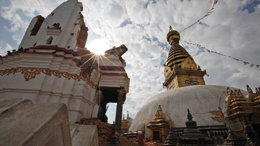 This Thursday, April 30, 2015 photo, shows a view of the famous Swayambhunath stupa after it was damaged in the April 25 massive earthquake in Kathmandu, Nepal. Swayambhunath, which dates back to the 5th century, is one of at least 68 cultural heritage sites in Nepal that were damaged by the earthquake. (AP Photo/Niranjan Shrestha)