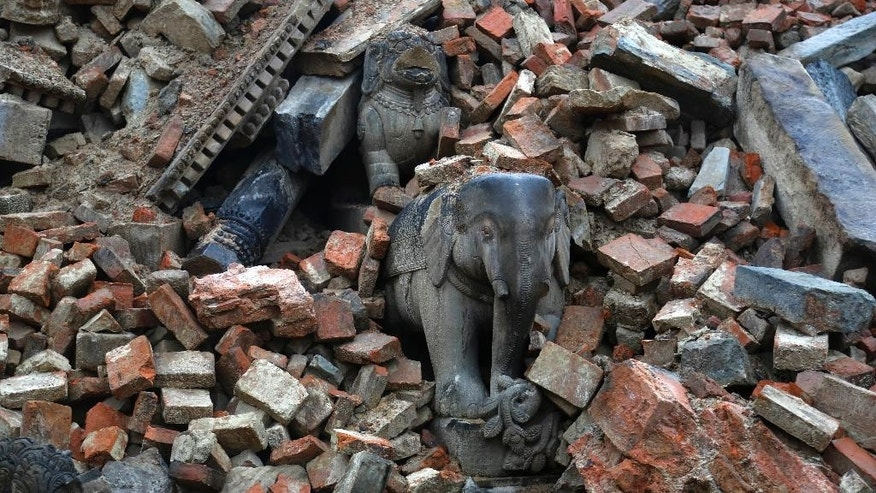 In this Thursday, April 30, 2015 photo, debris lies on the ground at Bhaktapur Durbar Square, a UNESCO World Heritage Site, after the April 25 massive earthquake, on the outskirts of Kathmandu, Nepal. Built between the 12th and 18th centuries, the square was traditionally used for coronation ceremonies  and religious festivals. (AP Photo/Manish Swarup)