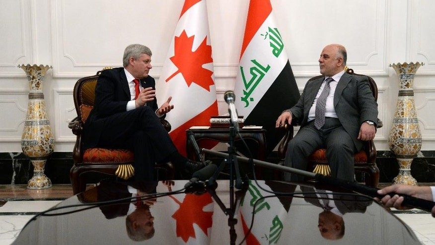Canadian Prime Minister Stephen Harper, left, meets with his Iraqi counterpart Haydar al-Abadi at the Presidential Palace in Baghdad, on Saturday, May 2, 2015. (Sean Kilpatrick/The Canadian Press via AP) MANDATORY CREDIT