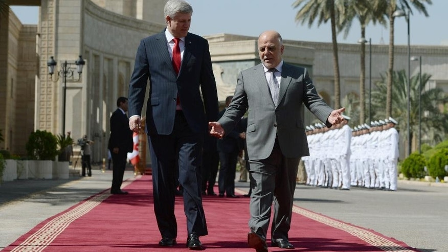 Canadian Prime Minister Stephen Harper meets with his Iraqi counterpart Haydar al-Abadi at the Presidential Palace in Baghdad, Iraq on Saturday, May 2, 2015. (Sean Kilpatrick/The Canadian Press via AP) MANDATORY CREDIT