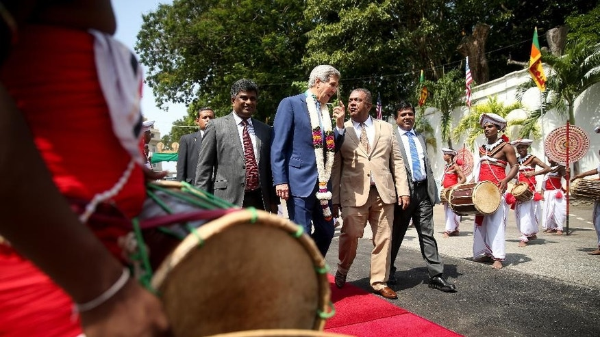 U.S. Secretary of State John Kerry, center, accompanied by Sri Lankan Deputy Foreign Affairs Minister Ajith Perera, left, and Sri Lankan Minister of Justice Wijeyadasa Rajapakshe, right, arrives for a meeting with Sri Lankan Foreign Minister Mangala Samaraweera, second from right, at the Ministry of Foreign Affairs, Saturday, May 2, 2015, in Colombo, Sri Lanka. Kerry is visiting Sri Lanka, Kenya, and Djibouti on his trip. (AP Photo/Andrew Harnik, Pool)