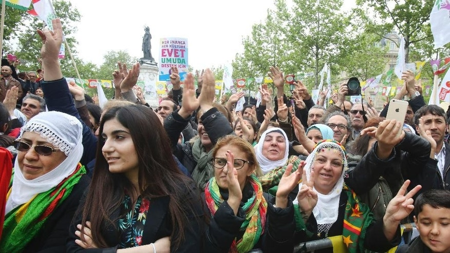 Kurds living in France are gathered in Paris, Saturday May, 2, 2015, to hear a speech by Selahattin Demirtas, co-chairman of pro-Kurdish Peoples' Democracy Party as part of his electoral campaign. Turkey will hold general election on June 7, 2015 to elect the 550 members of the Grand National Assembly. (AP Photo/Remy de la Mauviniere)