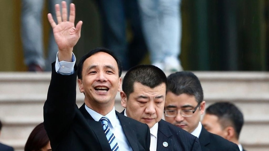 Eric Chu, center, chairman of Taiwan's ruling party Kuomintang waves as he leaves Fudan University in Shanghai, China, Saturday, May 2, 2015. Chu is leading a delegation to the cross-strait economic, trade and culture forum and will meet with Chinese President Xi Jinping on May 4. (Chinatopix via AP) CHINA OUT