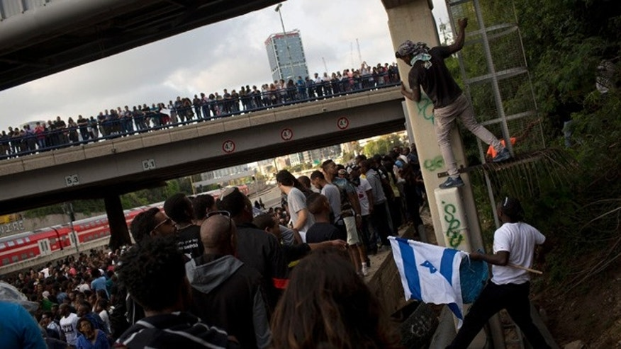 May 3, 2015 :Israel's Jewish Ethiopians block highway during a protest against racism and police brutality in Tel Aviv, Israel.