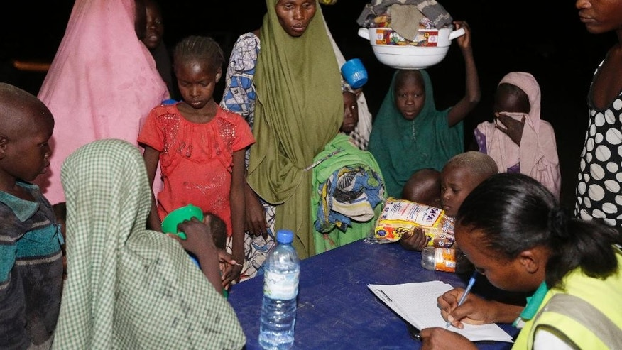 May 2, 2015: Women and children who were rescued by Nigerian soldiers from Boko Haram extremists at Sambisa Forest register their names upon their arrival at a refugee camp in Yola, Nigeria.