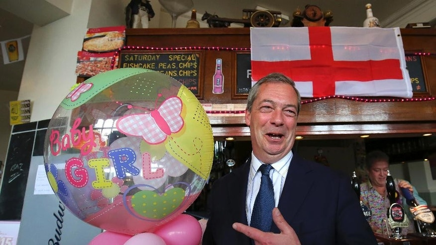 Britain's United Kingdom Independence Party (UKIP) leader Nigel Farage celebrates the birth of the Royal baby at a public house in Ramsgate, Kent, during a day of campaigning for the the upcoming general election on Saturday May 2, 2015. Britain goes to the polls on May 7. Kate, the Duchess of Cambridge, gave birth to a baby girl, royal officials said Saturday. (Gareth Fuller/PA via AP) UNITED KINGDOM OUT, NO SALES, NO ARCHIVE,