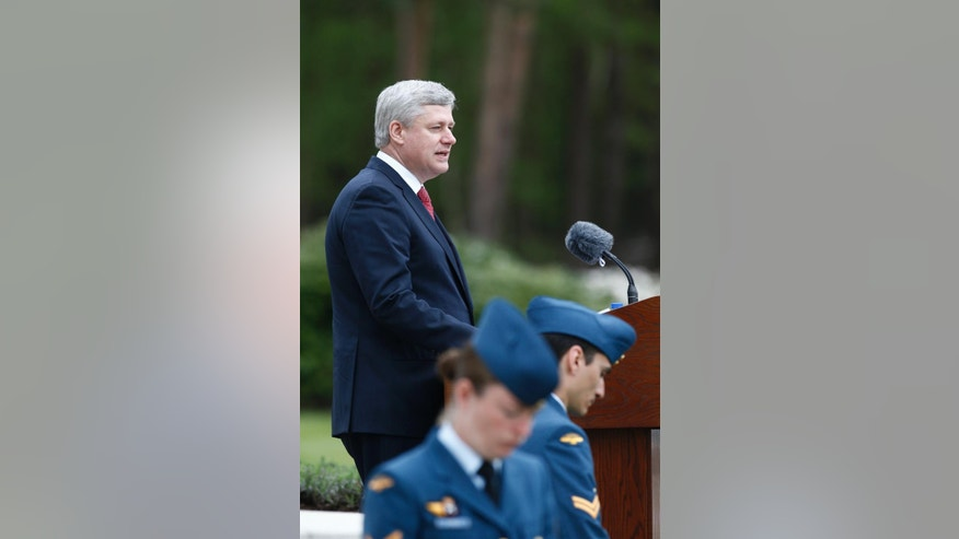 Canadian Prime Minister Stephen Harper speaks during memorial ceremonies in honor of Canadian soldiers who died during the liberation of the Netherlands in 1945 at the Canadian War Cemetery in Holten, east Netherlands, Monday, May 4, 2015. Harper is in the Netherlands to mark the 70th anniversary of the Liberation of the Netherlands. (AP Photo/Vincent Jannink)