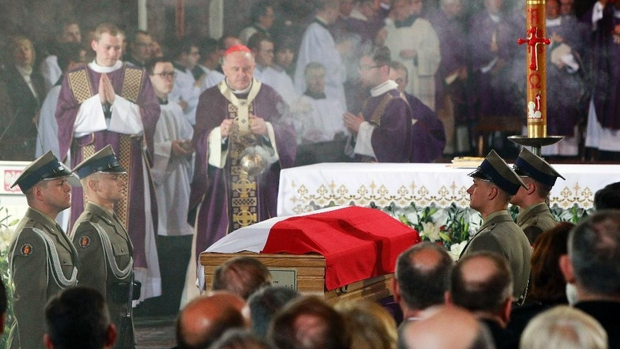Warsaw Cardinal Kazimierz Nycz celebrates a funeral mass at St. John's Arch-Cathedral, in Warsaw, Poland, on Monday, May 4, 2015 for Wladyslaw Bartoszewski, Poland's former foreign minister and a former Auschwitz prisoner who helped save Jews from the Holocaust. Bartoszewski, a historian, writer and politician, died suddenly on April 24 at the age of 93. (AP Photo/Czarek Sokolowski)