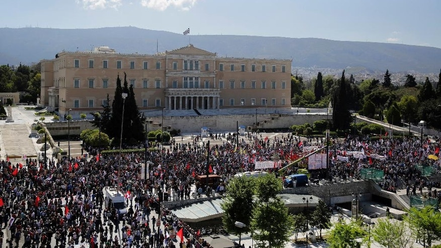Protestrers take part in a May Day rally  in central Athens, on Friday, May 1, 2015. In financially struggling Greece, an estimated 13,000 people took part in three separate May Day marches in Athens, carrying banners and shouting anti-austerity slogans. (AP Photo/Petros Giannakouris)