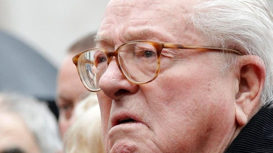France's far-right National Front party's founder Jean-Marie Le Pen watches after he placed a wreath at Joan of Arc statue during its annual May Day march, in Paris, France, Friday, May 1, 2015. France's far-right National Front is holding its annual May Day march, but for the first time the party's founder Jean-Marie Le Pen is not taking a seat at the tribune. (AP Photo/Francois Mori)