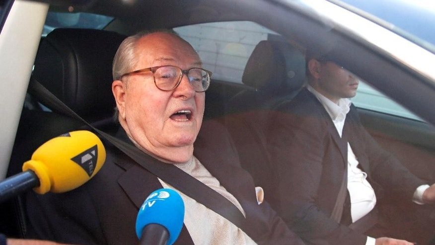 Jean-Marie le Pen, former head of far-right party National Front, arrives at the party headquarters in Nanterre, outside Paris, France, Monday, May 4, 2015. Jean-Marie  Le Pen goes before a party disciplinary board  over anti-Semitic remarks, in what could be the culmination of a high-stakes family feud. Rising stars within the party — especially his daughter, the current party leader — want to shut him up. (AP Photo/Michel Euler)