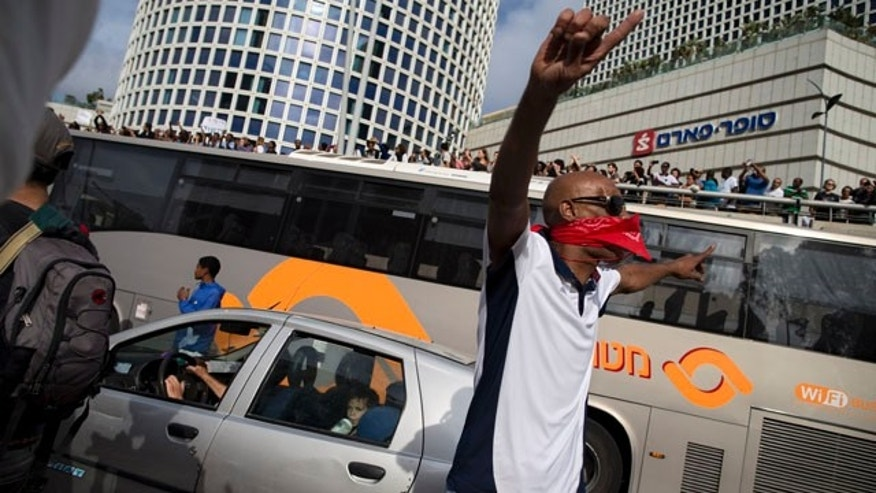 May 3, 2015: Israel's Jewish Ethiopians block a highway during a protest against racism and police brutality in Tel Aviv. (AP Photo/Oded Balilty)