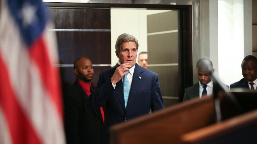 US Secretary of State John Kerry, centre,  arrives to speak at a news conference at the Nairobi Sankara Hotel, Monday, May 4, 2015, in Nairobi, Kenya. Kerry is visiting Sri Lanka, Kenya, and Djibouti on his trip. (AP Photo/Andrew Harnik, Pool)