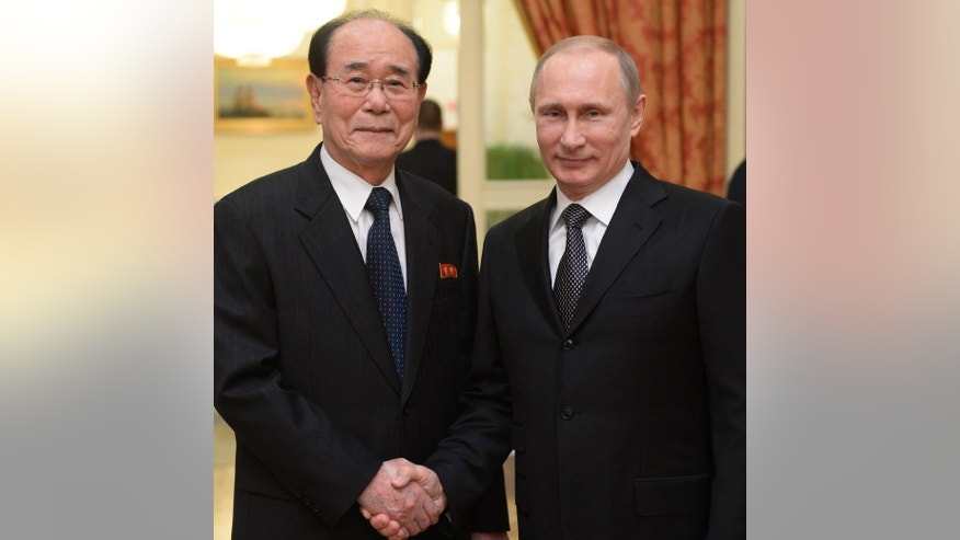 FILE - In this Feb. 7, 2014 file photo, Russian President Vladimir Putin, right, shakes hands with president of the Presidium of North Korea's Supreme People's Assembly Kim Yong Nam at the Olympic reception hosted by the Russian President in Sochi, Russia.  The North Korea's nominal head of state, not its absolute leader Kim Jong Un, is to visit Russia in May, 2015 to attend celebrations marking the 70th anniversary of the Soviet Union's victory over Nazi Germany.  Pyongyang's state media said Monday, May 4, 2015,  that Kim Yong Nam, president of the Presidium of the Supreme People's Assembly, will travel to Russia to take part in the ceremony. (AP Photo/RIA-Novosti, Alexei Nikolsky, Presidential Press Service, File)