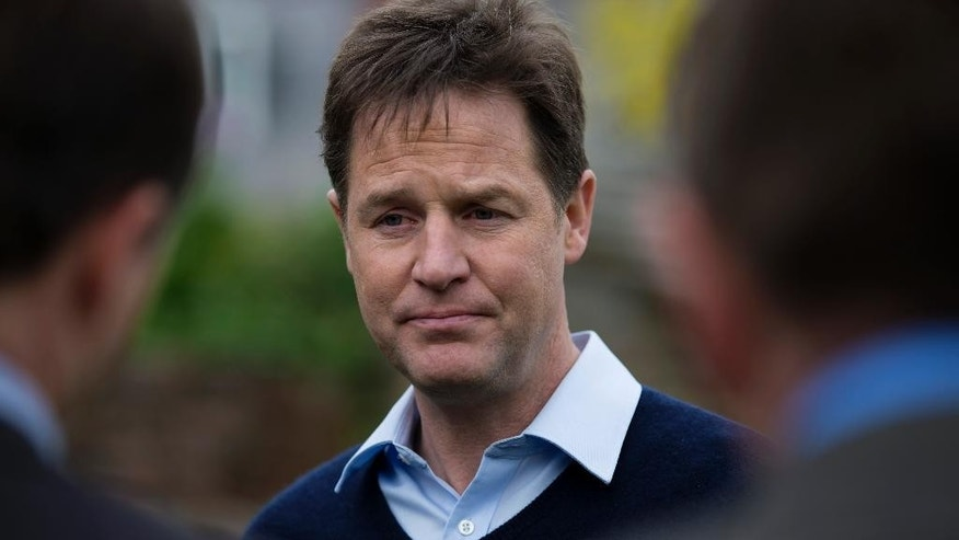 "In this photo taken Friday, April 24, 2015, Liberal Democrats party leader Nick Clegg speaks to members of the press at a pub, as Britain's political parties campaign in the lead up to the parliamentary elections on May 7, Sheffield, England. Nick Clegg's meteoritic rise in Britain's last electio transformed him from a relatively obscure leader of the left-of-center Liberal Democrats - Britain's third party and perennial ""also-rans"" - into deputy prime minister. Five years on, he may be headed for the political graveyard, paying for his decision to enter a marriage of convenience with the ruling Conservative Party. (AP Photo/Jon Super)"