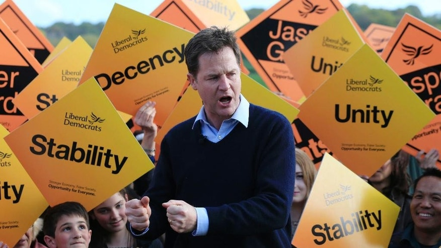 Liberal Democrat Party leader Nick Clegg speaks to supporters in Staplehurst, England, on the campaign trail Sunday May 3, 2015. Britain goes to the polls in a General Election on May 7. (Jonathan Brady / PA VIA AP) UNITED KINGDOM OUT - NO SALES - NO ARCHIVES