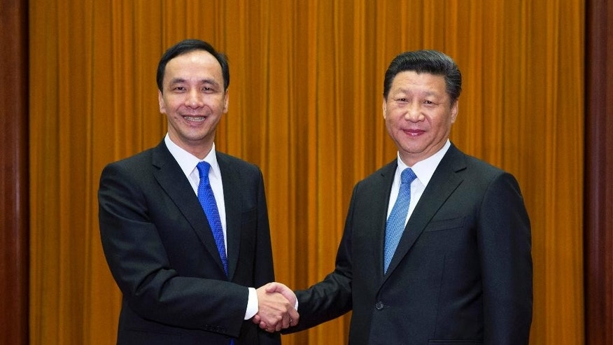 In this photo provided by China's Xinhua News Agency, Chinese President Xi Jinping, right, meets with Eric Chu, the head of Taiwan's ruling Nationalist Party in Beijing, Monday, May 4, 2015.  Chu, considered a likely candidate in next year's Taiwanese presidential elections,  called for more chances for the island to participate in international organizations following a meeting Monday with Chinese President Xi, whose government views the territory as a renegade province. (Lan Hongguang/Xinhua via AP) NO SALES
