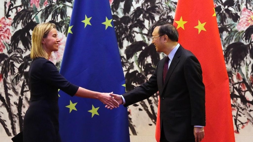 European Union Foreign Policy chief Federica Mogherini, left, shakes hands with China's State Councilor Yang Jiechi after a joint press conference at Diaoyutai State Guest House in Beijing, China, Tuesday, May 5, 2015. (AP Photo/Andy Wong)