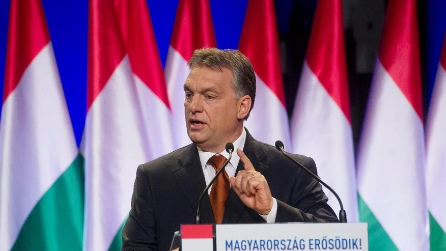 "FILE - In this Feb. 27, 2015 file photo Hungarian Prime Minister Viktor Orban delivers his annual ""state of the nation"" speech in Budapest, Hungary. A debate about restoring the death penalty has been a recurring issue with Orban since a 2002 bank robbery in which eight people were murdered. The inscription reads: ""Hungary Grows Stronger"". (Szilard Koszticsak/MTI via AP, File)"