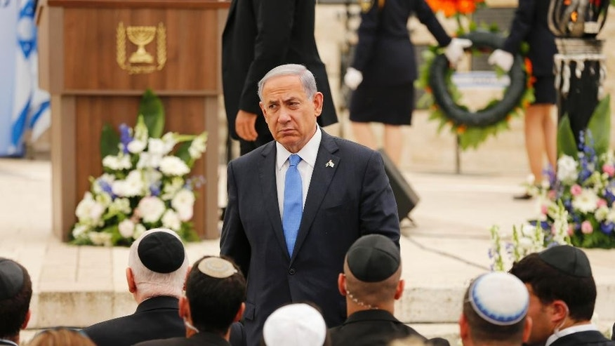 April 22, 2015: In this file photo, Israel's Prime Minister Benjamin Netanyahu leaves the podium after speaking during a Memorial Day ceremony to commemorate the country's fallen soldiers at Mount Herzl military cemetery in Jerusalem.