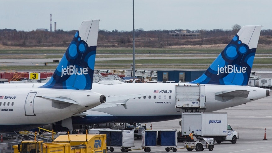 NEW YORK, NY - APRIL 23:  JetBlue planes sit at their gates at John F. Kennedy Airport on April 23, 2014 in the Queens borough of New York City. JetBlue pilots voted to unionize today by a 71% margin.  (Photo by Andrew Burton/Getty Images)