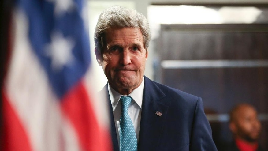 FILE - In this Monday, May 4, 2015 file photo, U.S. Secretary of State John Kerry arrives to speak at a news conference at the Nairobi Sankara Hotel in Nairobi, Kenya. Kerry is in Somalia on an unannounced visit, a show of solidarity with a government trying to defeat al-Qaida-allied militants and end decades of war in the African country. Kerry, the first top U.S. diplomat ever to visit the country, arrived at Mogadishu's airport around noon local time Tuesday, May 5. (AP Photo/Andrew Harnik, Pool, File)