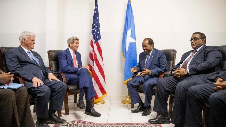 US Secretary of State John Kerry, accompanied by Special Representative for Somalia James McAnulty, left, meets with President Hassan Sheikh Mohammed, second from right, and Prime Minister Omar Abdirashid Ali Sharmarke, right, at the airport in Mogadishu, Somalia, Tuesday, May 5, 2015, in a show of solidarity with the Somalian government trying to defeat al-Qaida-allied militants and end decades of war in the African country.  Kerry is the first U.S. Secretary of State to ever visit the country. Kerry is also visiting Sri Lanka, Kenya, Djibouti, France, and Saudi Arabia on his trip. (AP Photo/Andrew Harnik, Pool)