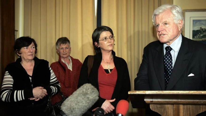 March 15, 2006: Sen. Edward M. Kennedy, D-Mass., as he speaks to the press as he stands with members of Robert McCartney's family, from left, mother Kathleen McCartney, aunt Emily McCartney, and sister Catherine McCartney, following their meeting on Capitol Hill Washington.