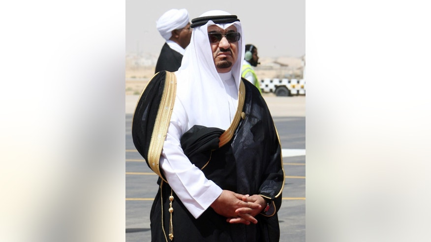 In this Tuesday, May 5, 2007 photo, the then Saudi chief of protocol Mohammed al-Tobayshi waits to welcome Arab leaders for the Arab Summit at the airbase in Riyadh, Saudi Arabia. Saudi King Salman has fired the chief of royal protocol after he was caught on camera slapping a photographer. The official Saudi Press Agency and local media reported Tuesday, May 5, 2015 that al-Tobayshi was replaced by Khalid al-Abbad, though no reason was given for the change. (AP Photo/Hassan Ammar)