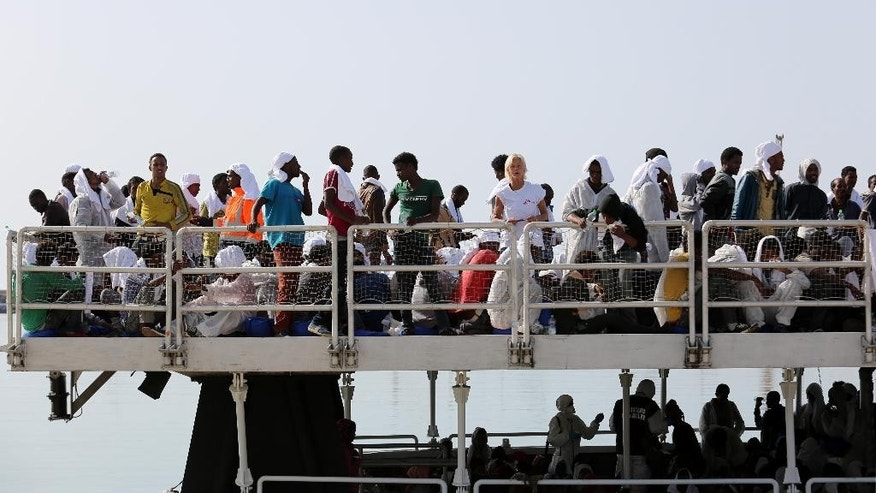May 5, 2015: Migrants wait to disembark from the ' The Phoenix ' a Malta-based Migrant Offshore Aid Station, in the Sicilian harbor of Pozzallo, Italy.  More than 350 migrants were on the Maltese-registered ship that brought them to safety, according to Doctors Without Borders who are helping with the rescue effort.