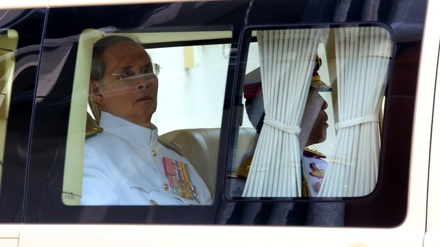 Thai King Bhumibol Adulyadej, left, and Thai Crown Prince Vajiralongkorn, right, leave Siriraj Hospital in Bangkok, Tuesday, May 5, 2015. Thailand's revered King Bhumibol Adulyadej made a rare public appearance Tuesday to mark the 65th anniversary of his coronation. (Phamorn Manapornchai/Daily News via AP) THAILAND OUT; NO SALES