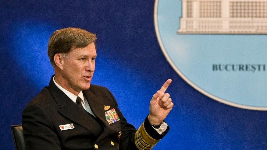 U.S Navy Adm. Mark E. Ferguson III, commander of the Allied Joint Force Command, speaks to media in Bucharest, Romania, Tuesday, May 5, 2015, hours after he announced the command will relocate from Naples, Italy,to Cincu, in mountainous central Romania, for 12 days in June to support a NATO exercise involving 1,000 troops from 21 NATO states. Ferguson, a top NATO commander, said the alliance will briefly move an allied joint force command headquarters to Romania as NATO continues to hone its ability to react to Russia's moves in Ukraine and other security challenges.(AP Photo/Vadim Ghirda)