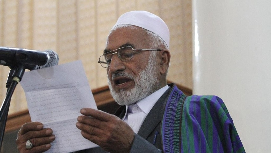 The father of a 27-year-old woman named Farkhunda, who was beaten to death by a mob, that was sparked by a bogus accusation that she had burned a copy of the Quran, speaks at a hearing at the Primary Court in Kabul, Afghanistan, Wednesday, May 6, 2015. The Afghan court on Wednesday convicted and sentenced four men to death for their role in the brutal mob killing in Kabul in March — a slaying that shocked the nation and spurred calls for authorities to ensure women's rights to equality and protection from violence. (AP Photo/Allauddin Khan)