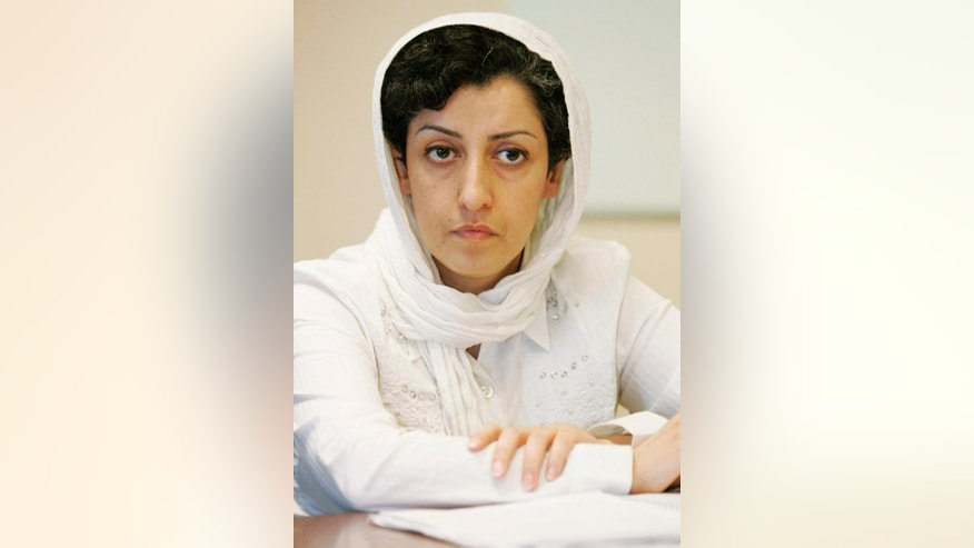 FILE - In this Monday, June 9, 2008 file photo, Iranian Narges Mohammadi, delegate of the Center for Human Rights Defenders, listens to a question during a press conference on the Assessment of the Human Rights Situation in Iran, at the U.N. headquarters in Geneva, Switzerland. Iranian opposition websites and rights groups focused on the country, such as the Kaleme.com website and the Norway-based Iran Human Rights group, said prominent human rights activist Mohammadi was arrested by state security forces Tuesday, May 5, 2015. (Magali Girardin/Keystone via AP, File)