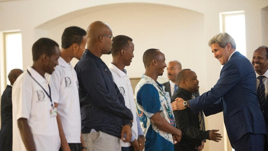 "U.S. Secretary of State John Kerry meets with youth at Salman Mosque in Dijbouti, Dijbouti, Wednesday, May 6, 2015. Kerry is also visiting Sri Lanka, Somalia, France, and Saudi Arabia on his trip. Kerry said Wednesday he intends to discuss with Saudi Arabian officials how to implement a ""humanitarian pause"" in Yemen's civil war, citing increased shortages of food, fuel and medicine that are adding to a crisis that has already caused some thousands of people to flee to neighboring countries.(AP Photo/Andrew Harnik, Pool)"