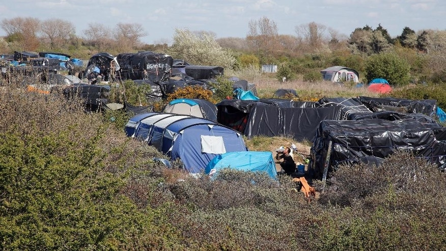 A makeshift camp of migrants near the Jules Ferry center, in Calais, northern France, Tuesday, April 28, 2015. They've come hundreds or thousands of kilometers to get here, and are determined to go make it just 50 kilometers more _ across the English Channel. Rumors circulate among the migrants that it's easier to find work or seek asylum in Britain than in France or other European countries along their journey.  (AP Photo/Francois Mori)